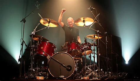 Iit's official - drummer CHRIS SLADE to reunite with AC/DC