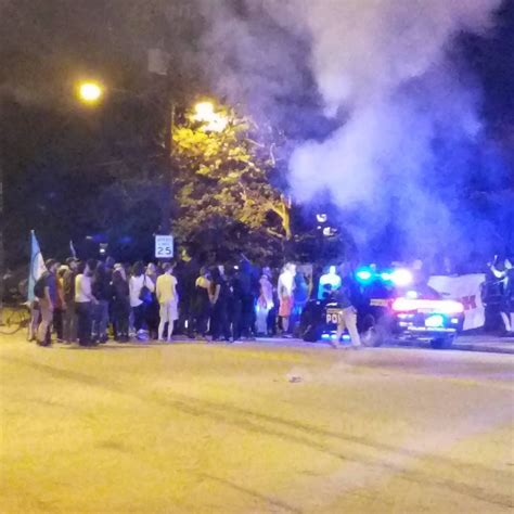 Violence flares after quiet vigil for Georgia Tech student